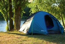 Tent on riverbank
