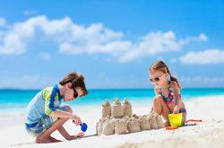 Kids on beach building sandcastles